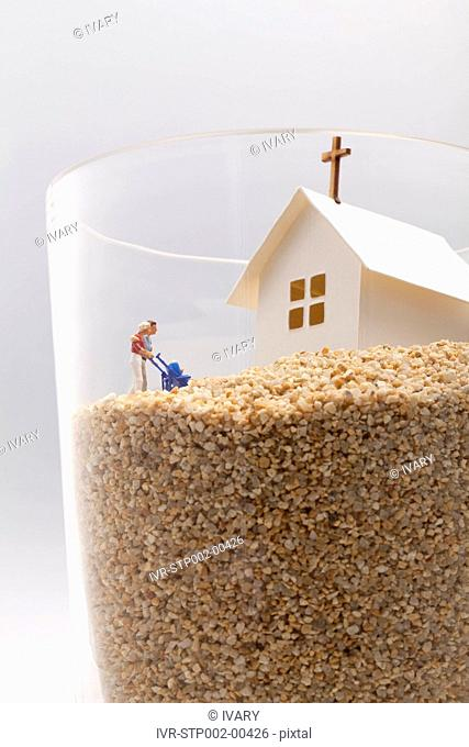Couple with child in the glass of sandstone moving towards church