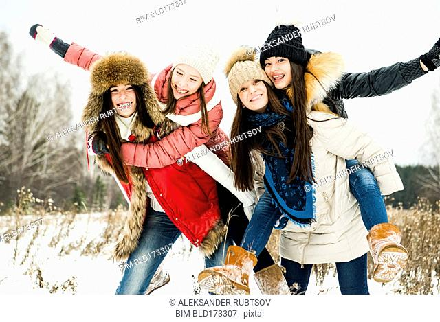 Caucasian girls playing in snow
