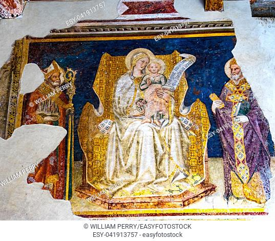 Madonna and Child Between Saints Gregory and Gimignano Fresco by Taddeo di Bartolo Outside San Gimignano Italy Fresco done in the early 1500s