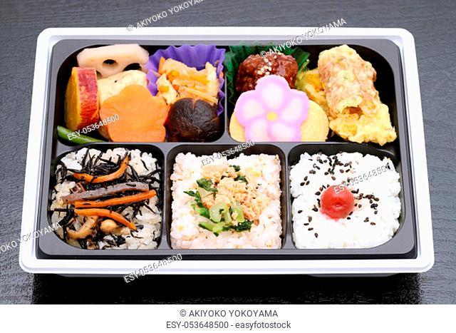Japanese Makunouchi bento lunch on a black background