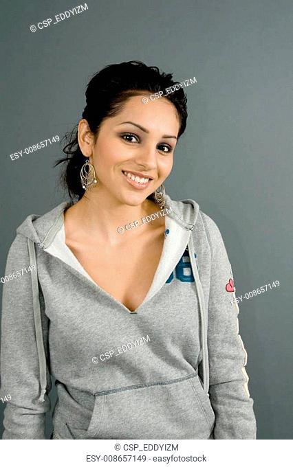 hispanic female in casual urban sweatshirt
