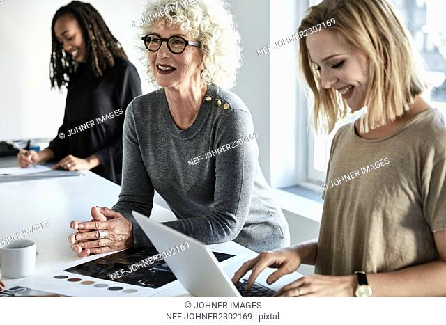 Women talking during business meeting in office