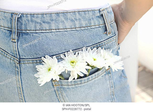 Woman with white flowers in back pocket