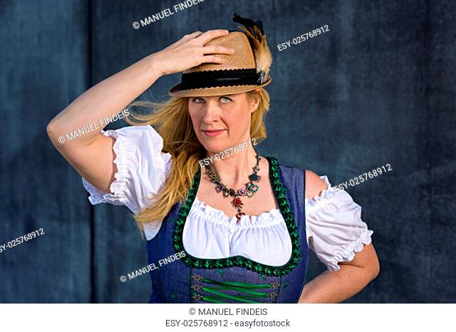 Beautiful Bavarian Woman with long blond hair in traditional clothing - ready for Oktoberfest, Series 14/21