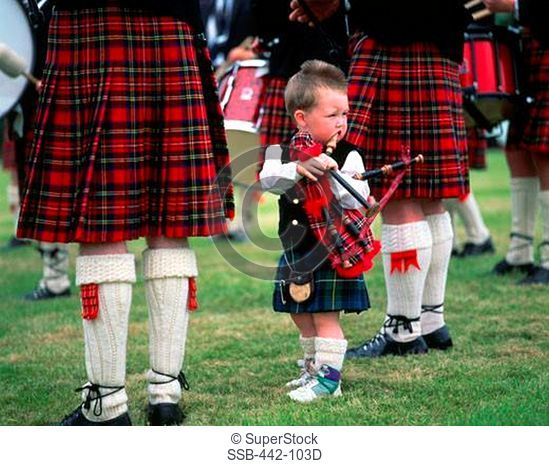 Boy standing with a bagpipe, Highland Games, Highlands, Scotland