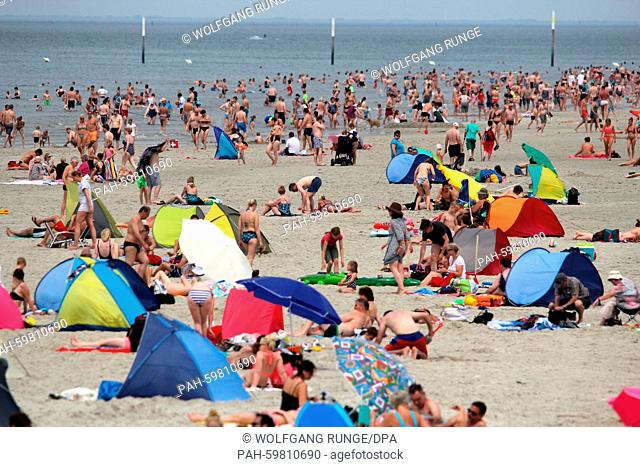 Holidaymakers enjoy the summer weather on the beach at St. Peter-Ording, Germany, 4 July 2015. PHOTO: WOLFGANG RUNGE/DPA   usage worldwide