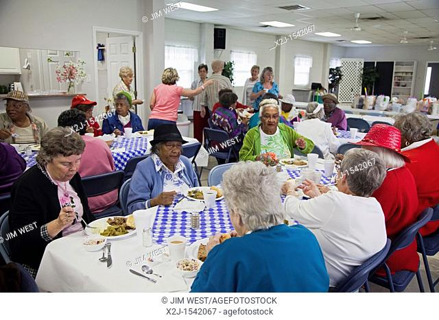 Knoxville, Tennessee - Low-income senior citizens are served lunch by members of the United Methodist Women at Asbury United Methodist Church  The weekly...