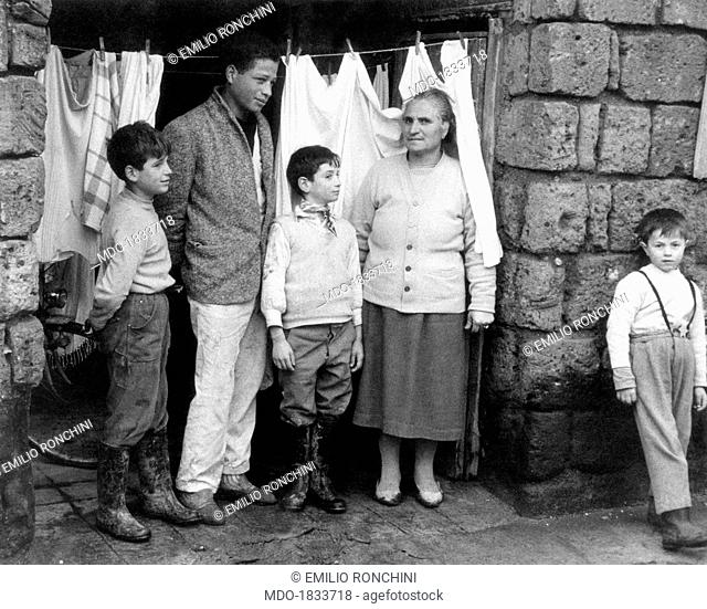 Salvatore Cappasina, born in 1944 to an Italian father and a Somali mother, is taken next to an old woman and three children, all white-skinned