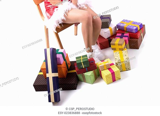 Christmas girl on a wooden chair and gifts