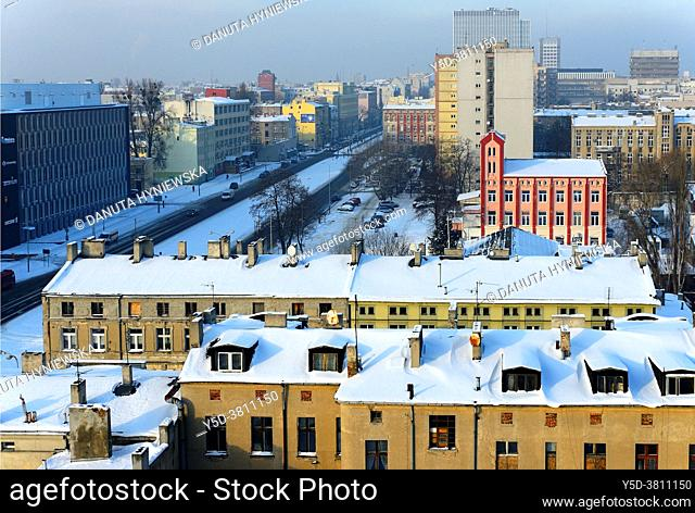 Panoramic view of city center of Lodz, in front historic tenement buidings, on left Kosciuszki Avenue, pink-red building in front is a part of former factory of...