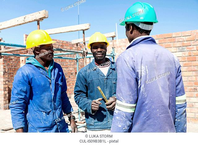 Builders talking on construction site