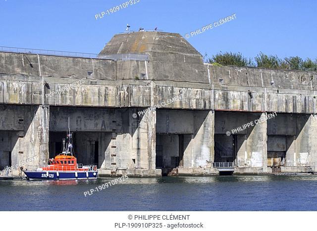 SNSM coast guard boat at the German WW2 Kriegsmarine submarine base in the port of Saint-Nazaire, Loire-Atlantique, France