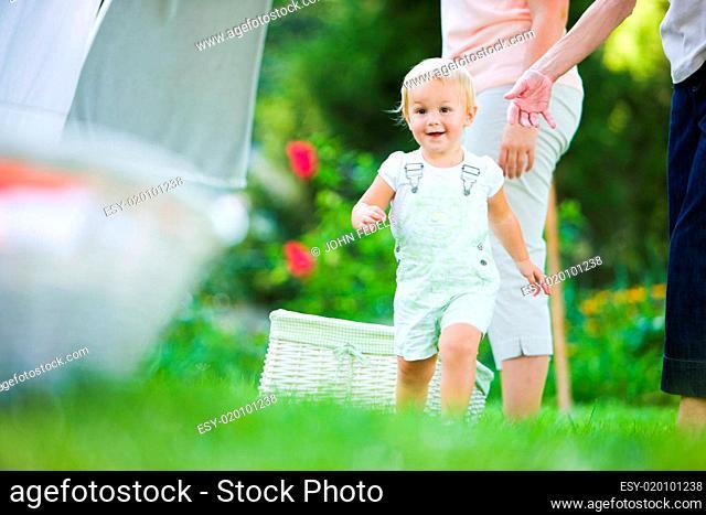 Child Running Near Clothesline