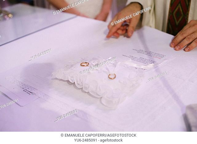 Wedding rings on the altar