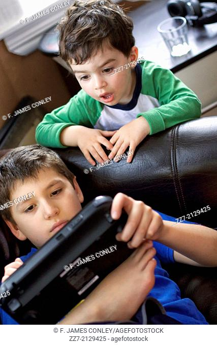 Young boys play a video game