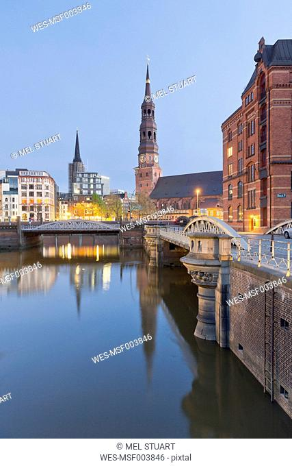 Germany, Hamburg, Bridge and church in Speicherstadt