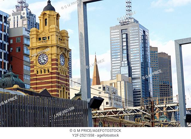 long view of Melbourne city buildings over Flinders Street Station