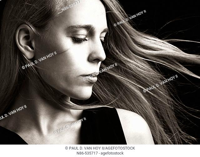 Woman with hair blowing, glamour
