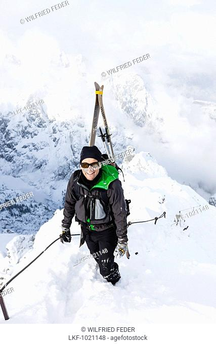 Ski mountaineer ascending via ferrata, Alpspitz, Garmisch-Partenkirchen, Upper Bavaria, Germany