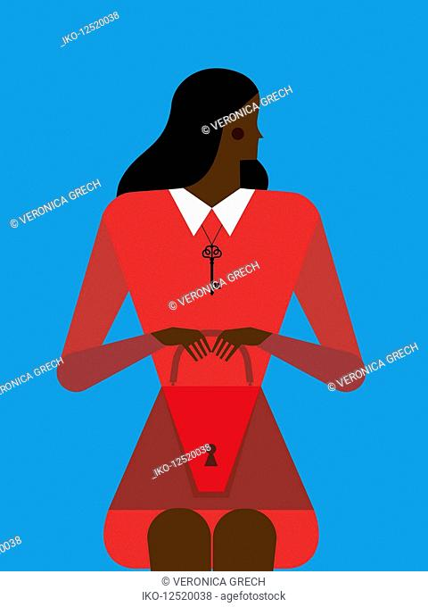Woman sitting wearing key on necklace and holding handbag with keyhole over her abdomen