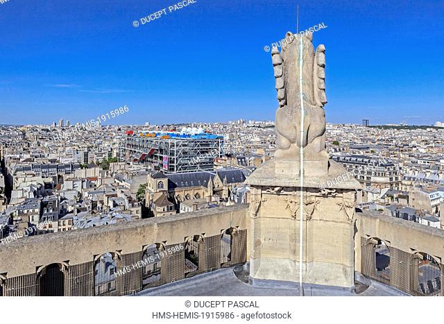 France, Paris, view on the Pompidou Center by the architects Renzo Piano, Richard Rogers and Gianfranco Franchini and a statue at the top of Tour Saint Jacques