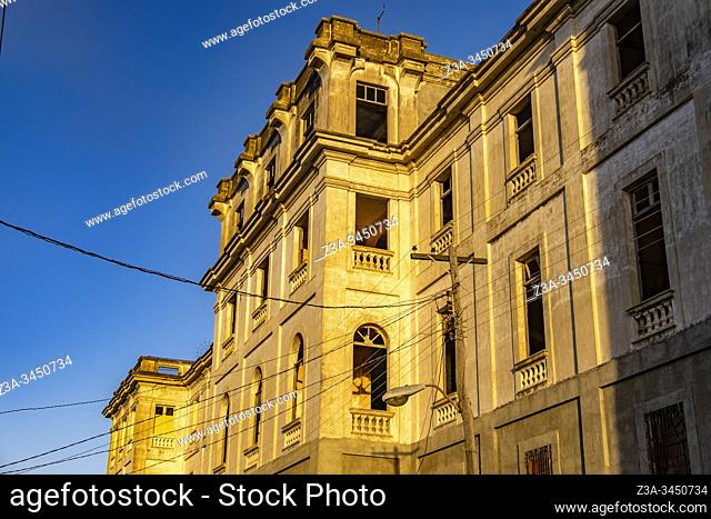 Old building in Cienfuegos with morning sunlight, Republic of Cuba, Caribbean, Central America