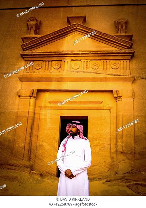 Saudi man standing at pre-Islamic archaeological site; Madain Saleh, Saudi Arabia
