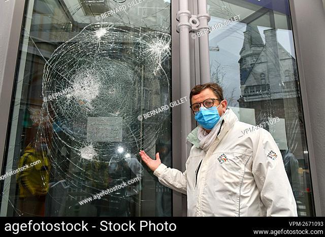 SNPS secretary general Thierry Belin shows a broken window at the Wallonia Liege Center police station, rue de la Regence