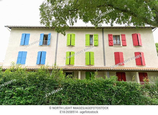EU, France, Toulouse. Colourful window shutters on the outside of an Auberge
