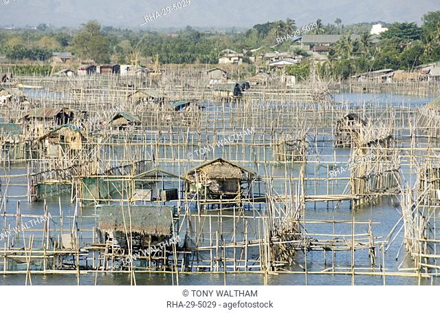 Fish pens in channel through wetlands at south end of Lingayen Gulf, near Dagupan, northwest Luzon, Philippines, Southeast Asia, Asia