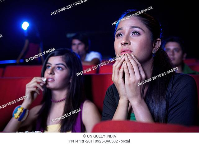 Youngsters watching movie in a cinema hall