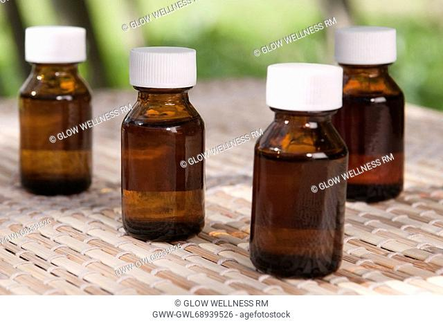 Close-up of aromatherapy oil bottles
