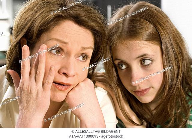 Female teenager consoling her mother