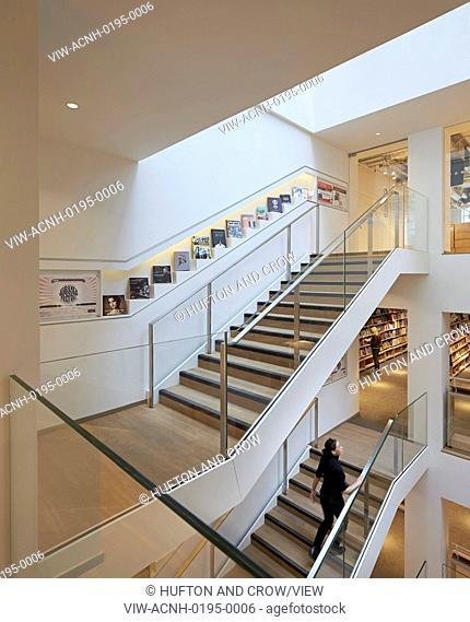 Stairwell with wall-inserted book display. Foyles, London, United Kingdom. Architect: Lifschutz, 2014