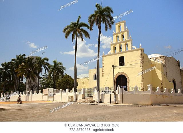 Cyclist in front of the church-Iglesia Adventista del Septimo D'a de Chumayel at the town center, Chumayel, Convent Route, Yucatan Province, Mexico