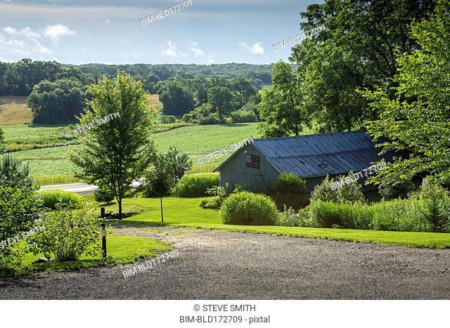 Barn building on farm in rural landscape