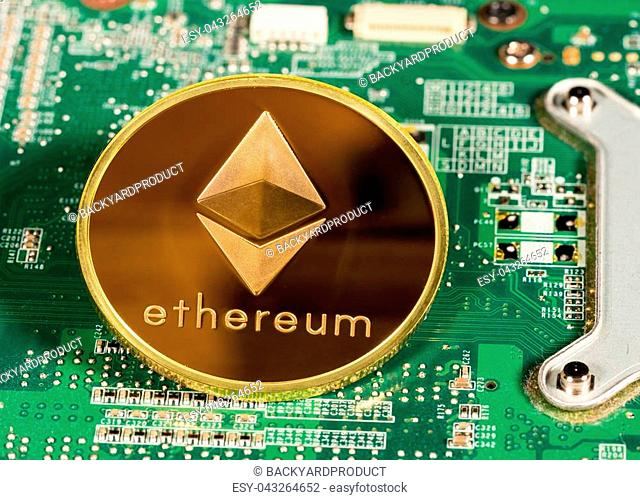 Ethereum or ether coin on a computer board to illustrate blockchain and cyber currency