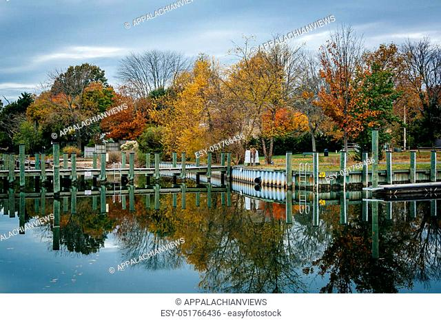 Docks and autumn color at Oak Creek Landing, in Newcomb, near St. Michaels, Maryland