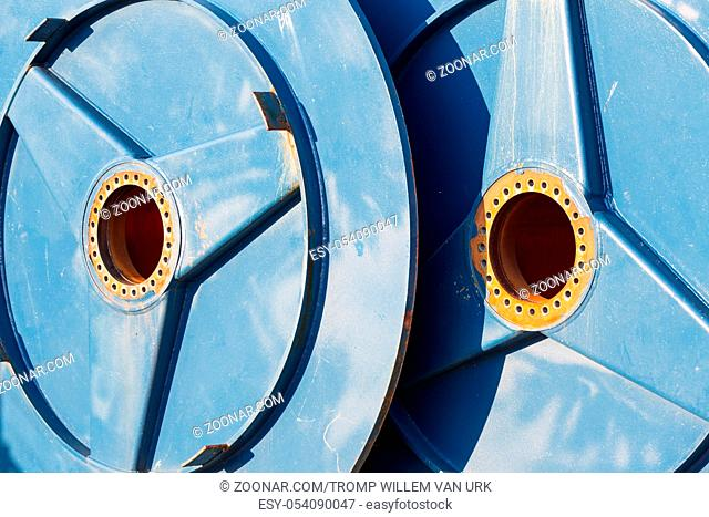 Two big metal spools with hole for drive shaft