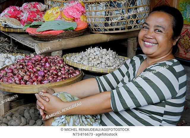 Vendor smiling at local market, Antosari, Bali, Indonesia