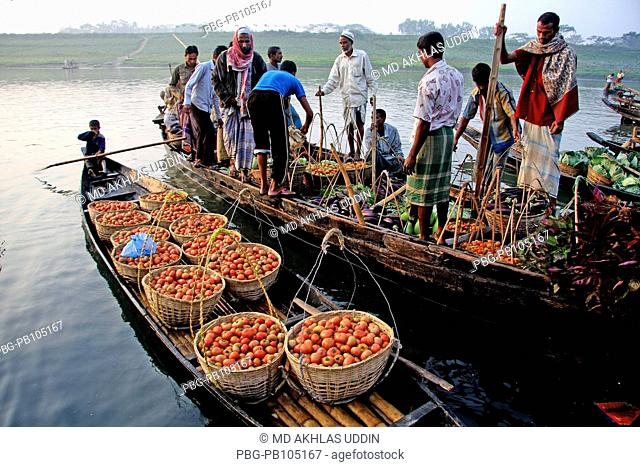 Fresh vegetables are collected by boat at Guker Bazar wholesale market for sale Sylhet, Bangladesh February, 2010