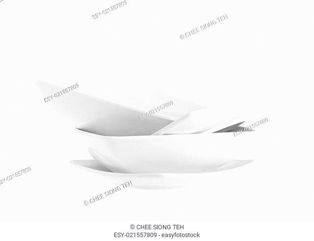 Stack of plain white dinner plates isolated on white background