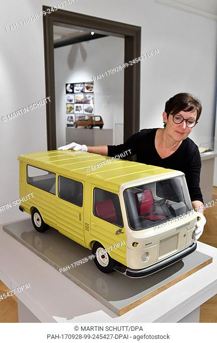 Curator Doris Weilandt stands next to a model of the Barkas 1100 from 1968 at the exhibition 'Barkas, Simson, Moccadolly - Lutz Rudolph (1936-2011)Fahrzeug-...