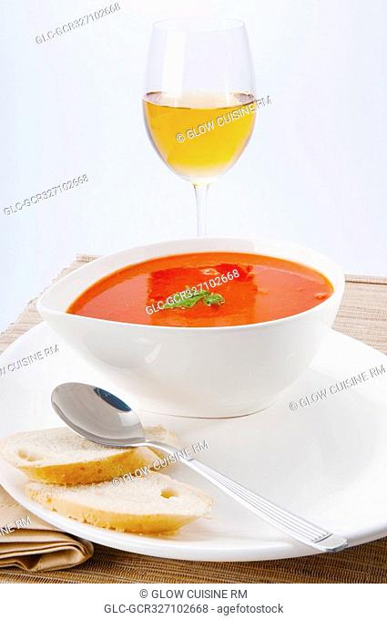 Close-up of tomato soup served with white wine