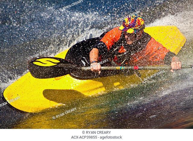 A young man freestyle kayaking on Skookumchuk ocean rapids, Skookumchuck Narrows Provincial Park, Egmont, British Columbia, Canada