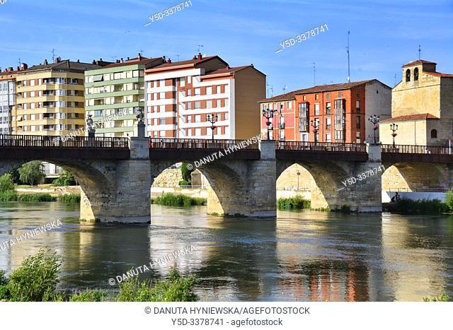 Miranda de Ebro view across Ebro river, new apartment buildings, Iglesia Espiritu Santo and Puente de Carlos III - Carlos III bridge, Burgos province