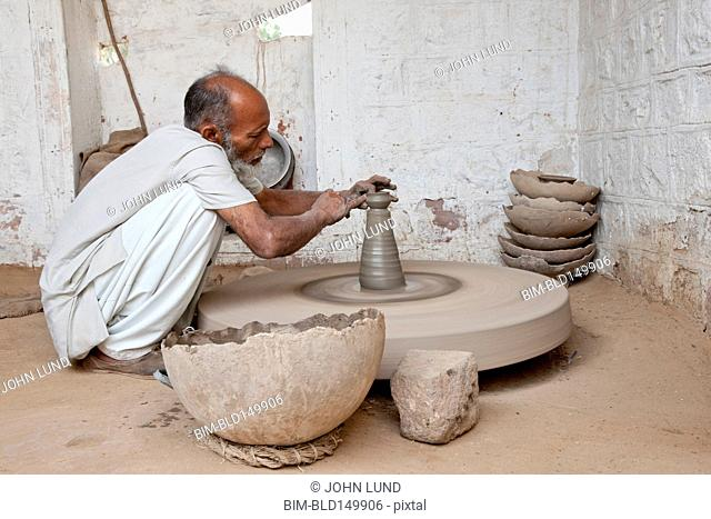 Indian man working at potter's wheel