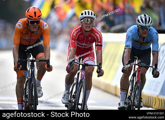 Dutch Dylan Van Baarle, Danish Michael Valgren Hundahl and Belgian Jasper Stuyven sprint to the finish of the elite men road race of the UCI World Championships...
