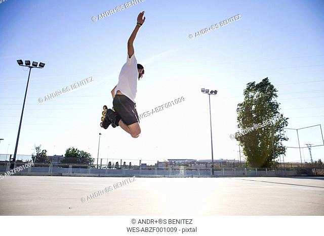 Man with rollerblades jumping during a skating session