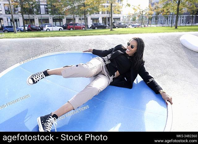 Brazilian woman in playground, Munich, Germany